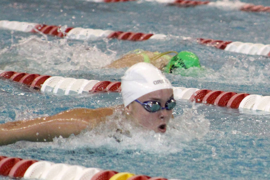 Green Valley's Liz Clinch competes in the 100 butterfly during the Class 4A state championships on Saturday, May 19, 2018 at UNLV. Clinch won the event in 55.69 seconds. (Tim Guesman/Las Vegas Rev ...