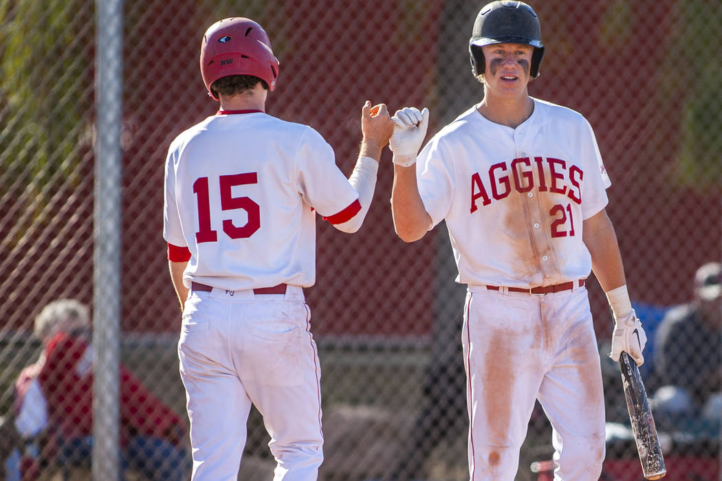 Arbor View pitcher and infielder Austin Pfeifer (21) celebrates with infielder Bradley Stone after Pfeifer hit a home run during the fifth inning at Arbor View High School in Las Vegas on Tuesday, ...