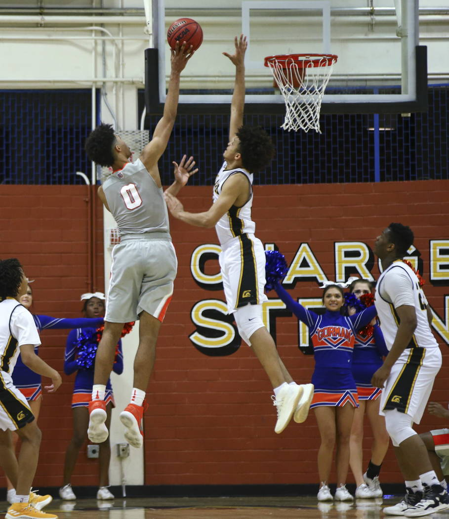 Bishop Gorman's Isaiah Cottrell (0) goes to the basket as Clark's Jalen Hill (21) attempts to block during a basketball game at Clark High School in Las Vegas on Tuesday, Jan. 30, 2018. Chase Stev ...
