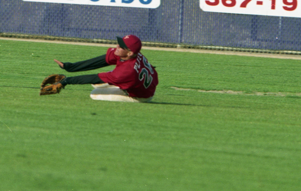 Las Vegas High's Anthony Pluta dives for a ball in the outfield. (Review-Journal file photo)
