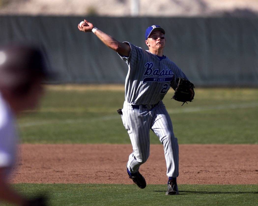 Basic High School third baseman Micah Schnurstein throws to first base during a game against host Cimarron-Memorial High School Tuesday, March 19, 2002. RJ Photo by K.M. Cannon