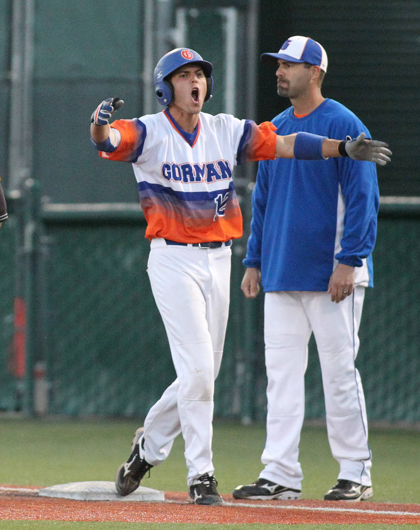 Bishop Gorman's Kenny Meimerstorf yells to his teammates after hitting a two-run single in a fifth inning rally against Reno High in the 4A baseball state tournament at the University of Nevada, R ...