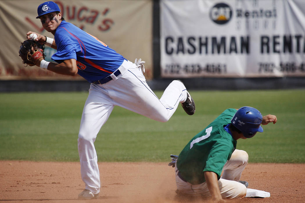 Bishop Gorman's Joey Gallo looks to turn a double play as Green Valley's Even Van Hoosier slides into second base during the Nevada State 4A Baseball Championship game at Morse Stadium at CSN in H ...