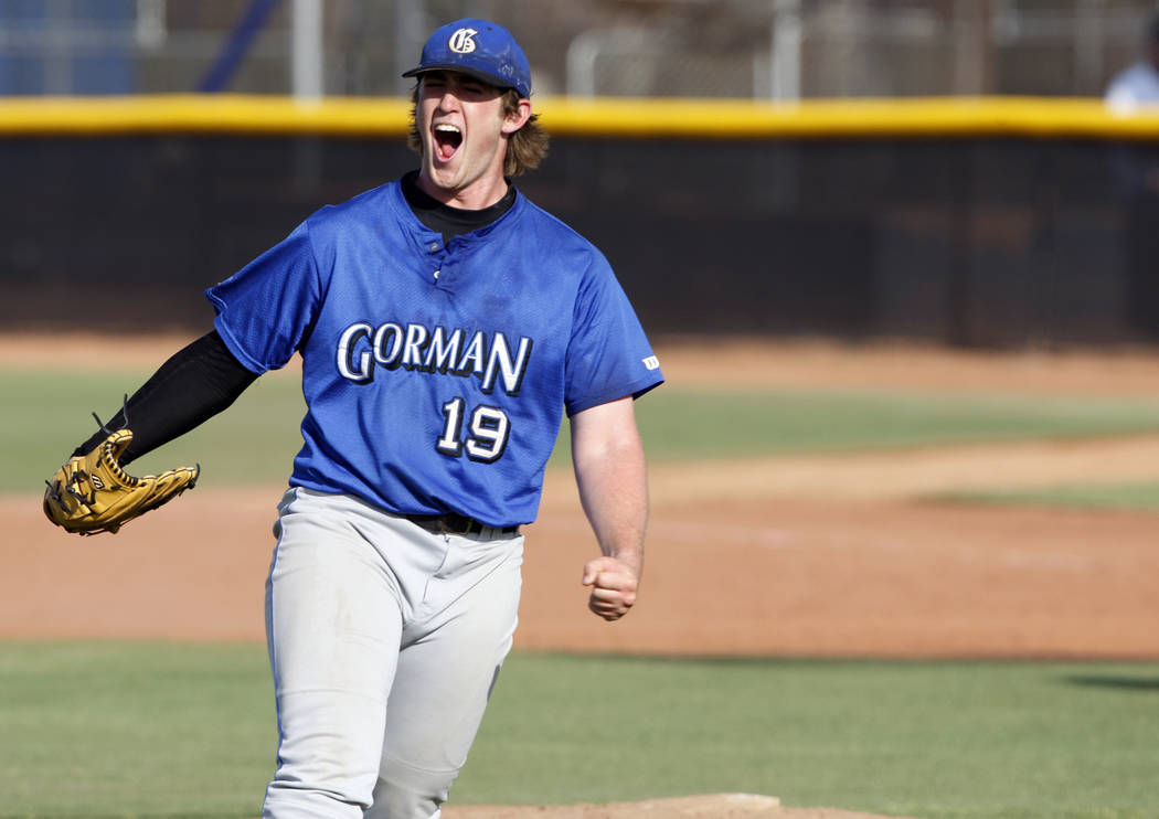 Bishop Gorman High School pitcher Jeff Malm celebrates after striking out the final Green Valley batter to win the Class 4A State Championship quarterfinal baseball game at College of Southern Nev ...