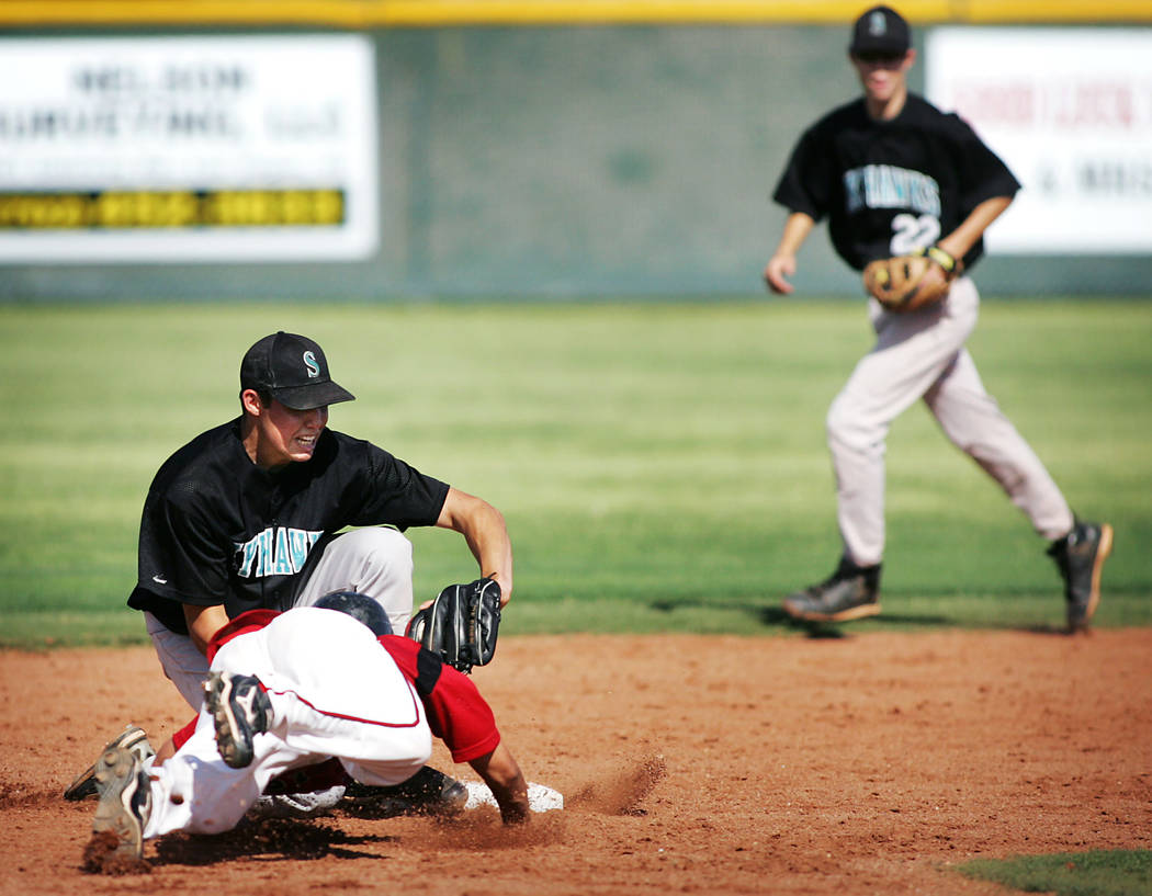 Las Vegas High School baseball player Timothy Daniel gets picked off by Silverado shortstop Drew Robinson as he attempts to slide into second base during their Sunrise Region Baseball Tournament g ...