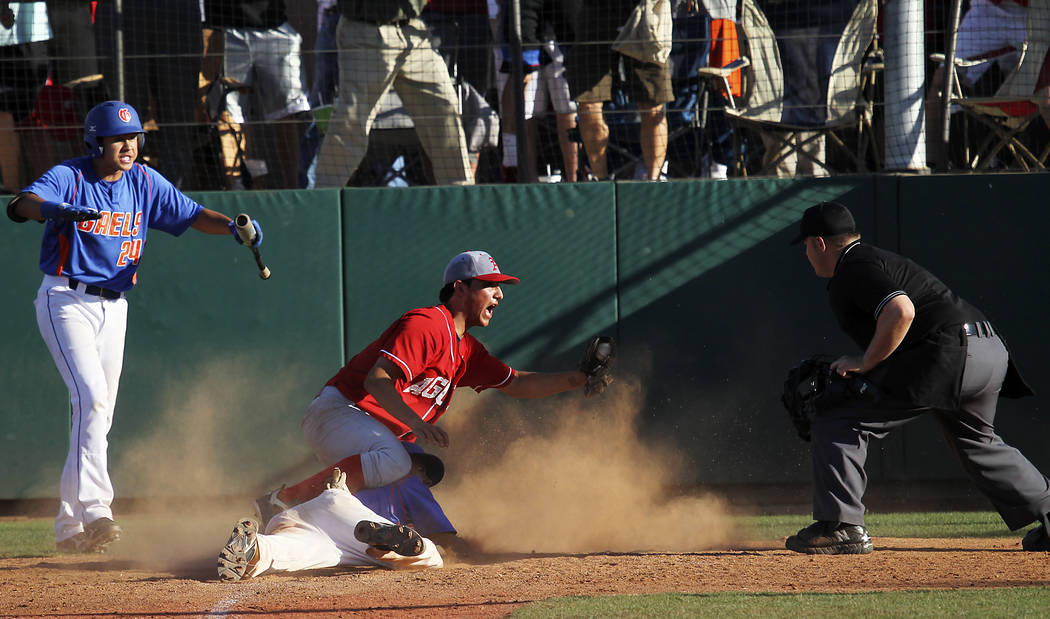 Arbor View's Zach Quintana shows the ball to the umpire after tagging out Bishop Gorman's Willie Jumper at home plate to end the game during a Sunset Region baseball game at Bishop Gorman on Wedne ...