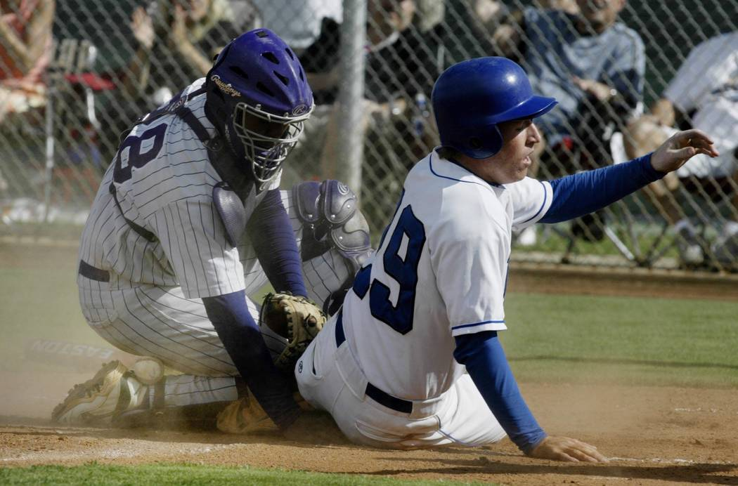 Durango catcher Mike McDade #28 searches for the ball under Sierra Vista baserunner Drew Leary only to find it moments late between stuck between his leg and ankle. The tigers scored in the bottom ...