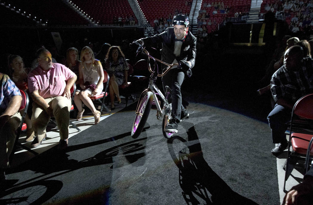 Professional BMX rider and television personality Ricardo Laguna rides to the stage before presenting during the Best Of Nevada Preps Awards at the Thomas & Mack Center in Las Vegas on Sunday, ...