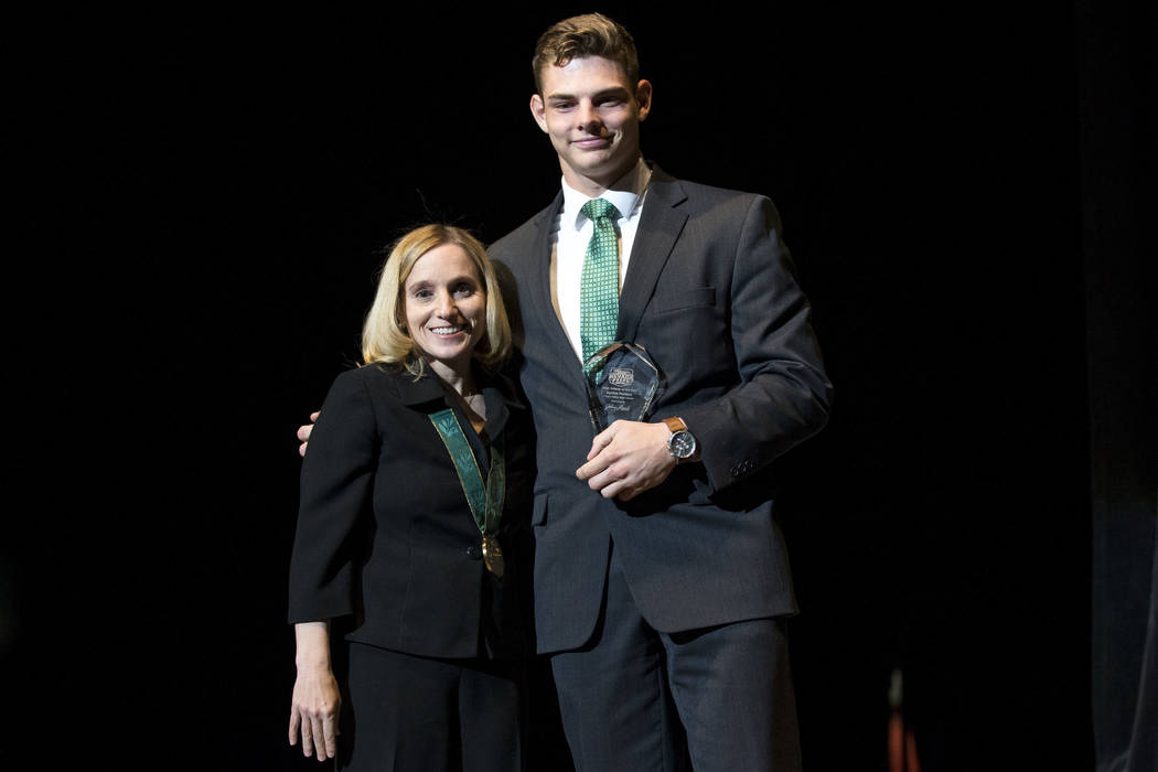 Olympic gold medalist Kerri Strug, left, poses with Jayden Perkins, Virgin Valley High School's Male Athlete of the Year, during the Best Of Nevada Preps Awards at the Thomas & Mack Cente ...