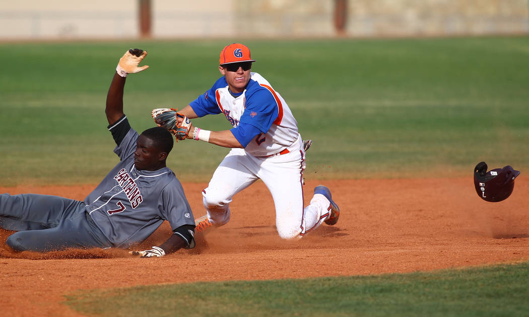 Bishop Gorman's Cadyn Grenier (2) tags out Cimarron-Memorial's Micquel Robinson at second base in the seventh inning on Monday. The Gaels won, 9-4. (Chase Stevens/Las Vegas Review-Journal)
