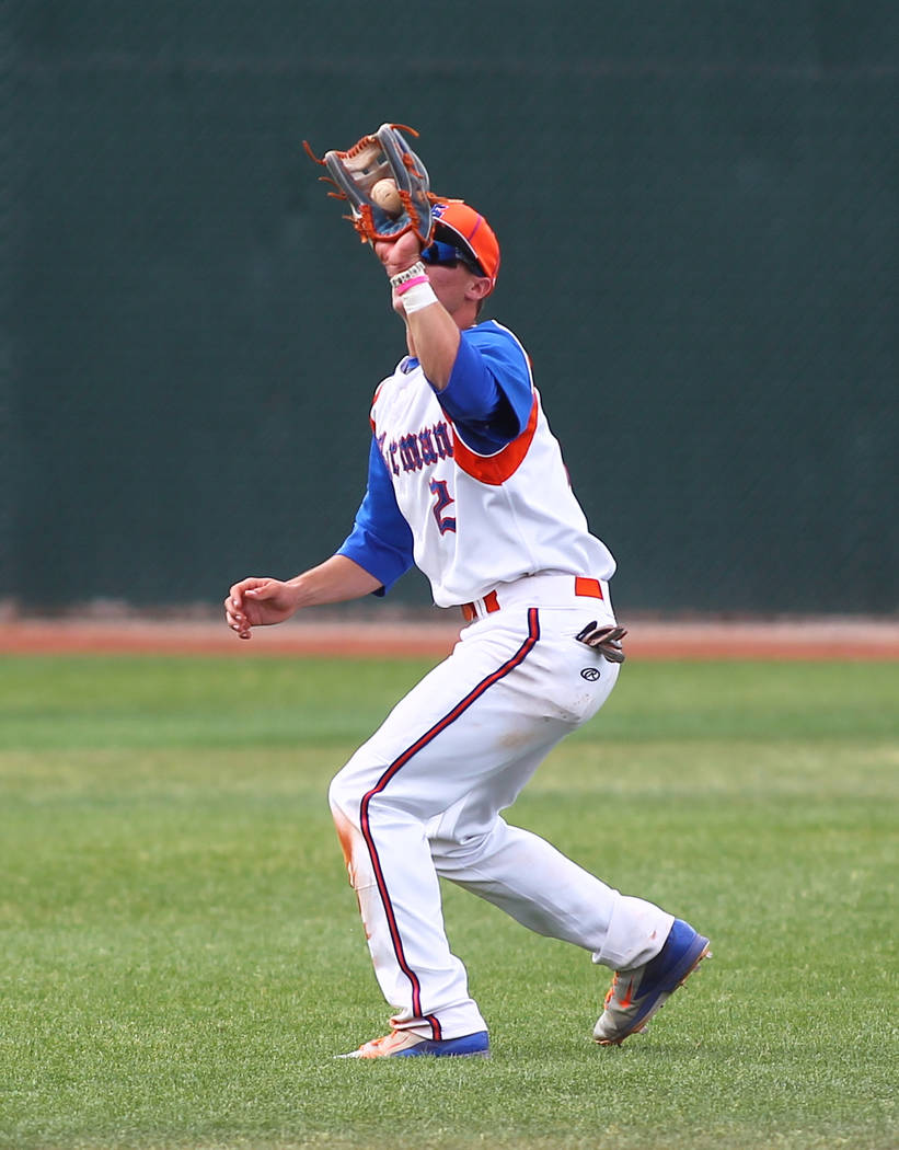 Bishop Gorman's Cadyn Grenier (2) catches a pop fly of the bat of Cimarron-Memorial's Larry Quaney in the second inning on Monday. Grenier doubled twice and scored a run as the Gaels won, 9-4. (Ch ...