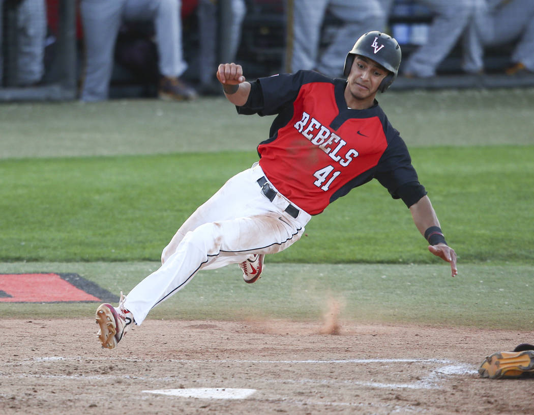 UNLV's Nick Rodriguez (41) slides in to home base to score a run against Arizona State during a baseball game at Wilson Stadium in Las Vegas on Tuesday, April 18, 2017. Chase Stevens Las Vegas Rev ...