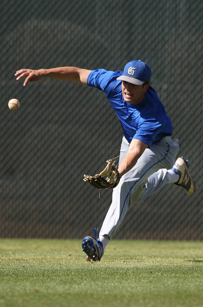 Bishop Gorman senior Austin Wells dives for a ball during practice on Monday, April 16, 2018, at Bishop Gorman High School, in Las Vegas. Wells has committed to play baseball at the University of ...