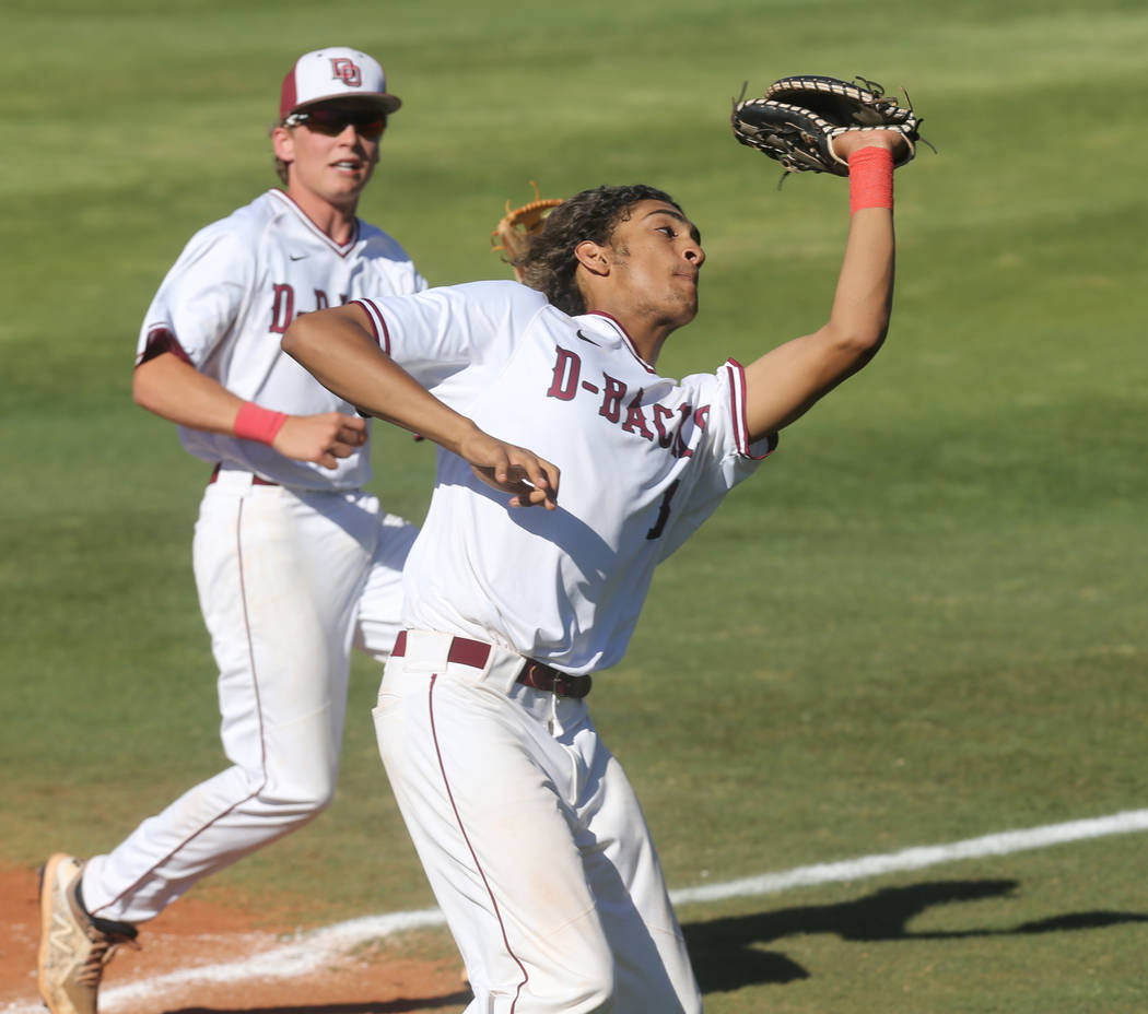 Desert Oasis Desert Oasis D.J. Jefferson (16) catches a foul ball as Parker Schmidt (4) backs up in the third inning of their baseball game at Desert Oasis High School in Las Vegas Monday, April 2 ...
