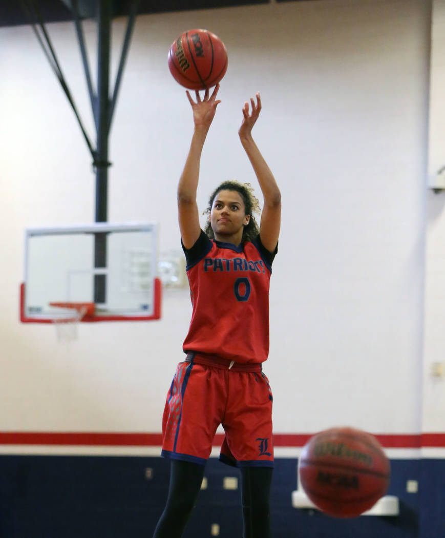 Liberty High's Rae Burrell shoots for the basket during teams practice at their school on Tuesday, Feb. 20, 2018, in Las Vegas. Bizuayehu Tesfaye/Las Vegas Review-Journal @bizutesfaye