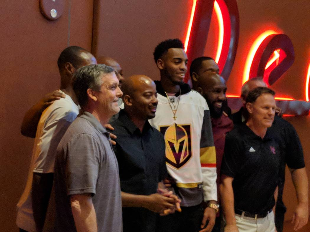 Former Centennial High School basketball star and Oregon Duck Troy Brown Jr., wearing a Golden Knights jersey, poses for a photo at Red Rock Resort after being drafted No. 15 overall by the Washin ...