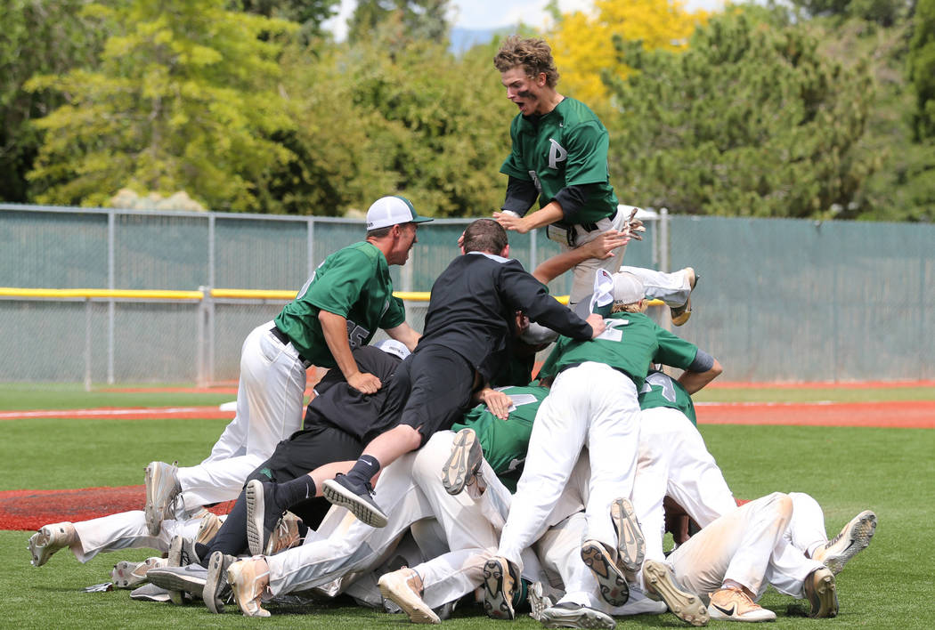 Palo Verde players celebrate their 4-2 win over Basic for the NIAA 4A baseball championship in Reno, Nev., on Saturday, May 19, 2018. Cathleen Allison/Las Vegas Review-Journal