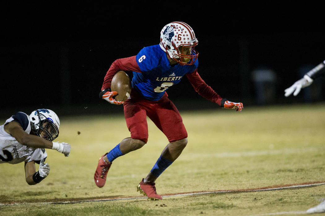 Liberty's Cervontes White (6) runs the ball against Foothill in their football game at Liberty High School in Henderson, Friday, Oct. 6, 2017. Erik Verduzco Las Vegas Review-Journal @Erik_Verduzco