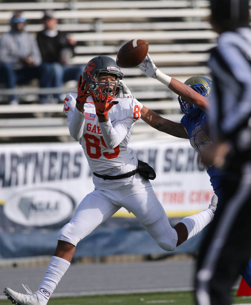 Bishop Gorman's Rome Odunze tries to make a catch under pressure from Reed's George Moreno during the first half of the NIAA 4A state championship football game in Reno, Nev., on Sat ...