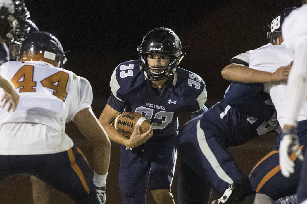 Quarterback Kody Presser (33) runs the ball during a Legacy High School Shadow Ridge High School game at Legacy High School in North Las Vegas on Friday, Nov. 4, 2016. Loren Townsley/Las Vegas Rev ...