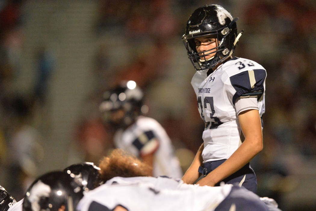 Shadow Ridge quarterback Kody Presser (33) looks to his sideline during the Arbor View High School Shadow Ridge High School game at Arbor View in Las Vegas is seen on Friday, Sept. 30, 2016. Brett ...