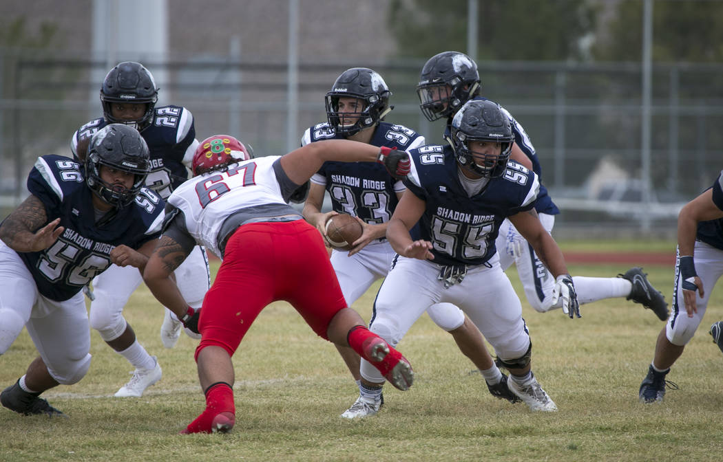 Shadow Ridge quarterback Kody Presser (33) looks for the hand off during a football game against Arbor View at Shadow Ridge High School on Saturday, Sept. 23, 2017, in Las Vegas. Richard Brian Las ...