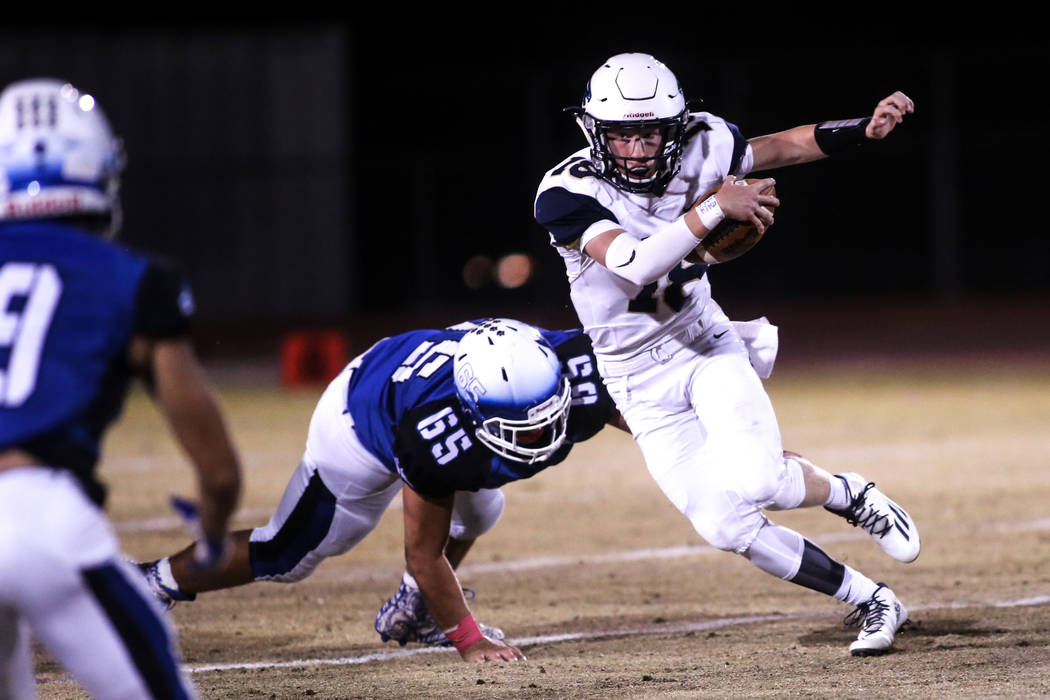 Foothill's Koy Riggin (18), right, runs past Basic's Julio Duron (65), center, during the second quarter of a football game at Basic High School in Henderson, Friday, Oct. 20, 2017. Joel Angel Jua ...