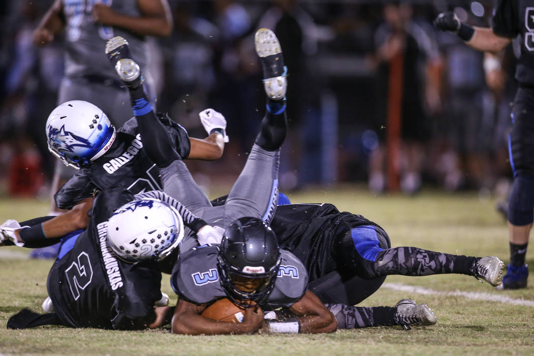 Canyon Springs' Jayvion Pugh (3) is tackled by Basic during the second quarter of a football game at Basic Academy of International Studies in Henderson, Friday, Sept. 15, 2017. Joel Angel Juarez ...