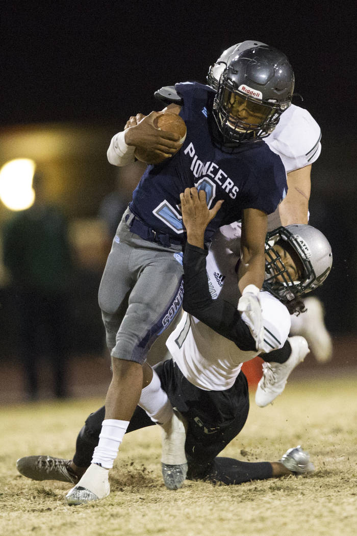 Green Valley's Daunte Watson (1) tackles Canyon Springs' Jayvion Pugh (3) in the playoff football game at Canyon Springs High School in Las Vegas, Thursday, Nov. 9, 2017. Green Valley won 14-7. Er ...