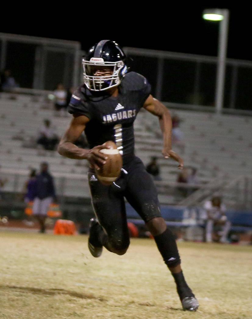 Desert Pines' quarterback Tyler Williamson runs with the ball against Sunrise Mountain at Desert Pines High School in Las Vegas, Friday, Oct. 20, 2017. Elizabeth Brumley Las Vegas Review-Journal @ ...