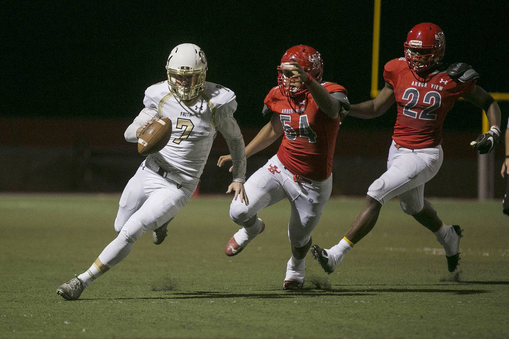 Faith Lutheran quarterback Sagan Gronauer (7) runs the ball with Arbor View players Tai Tuinei (54) and Elijah Wade (22) following behind during the first half of the game at Arbor View High Schoo ...