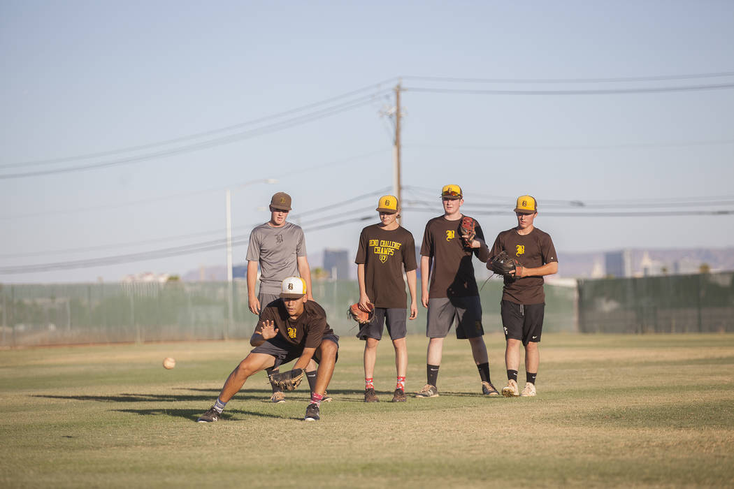 Bonanza High School's Keanu Atienza catches the ball in front of his teammates during practice at Bonanza High School in Las Vegas, Tuesday, July 3, 2018. Rachel Aston Las Vegas Review-Journal @ro ...