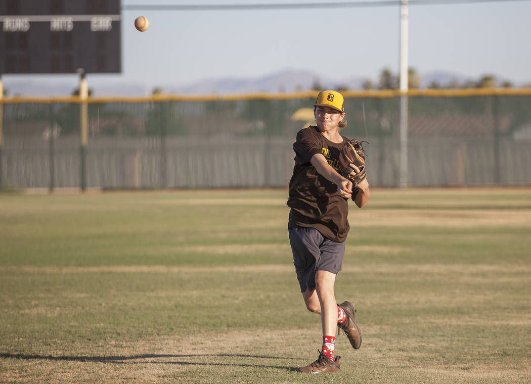 Bonanza High School's Robert Shook throws the baseball to a teammate during practice at Bonanza High School in Las Vegas, Tuesday, July 3, 2018. Rachel Aston Las Vegas Review-Journal @rookie__rae