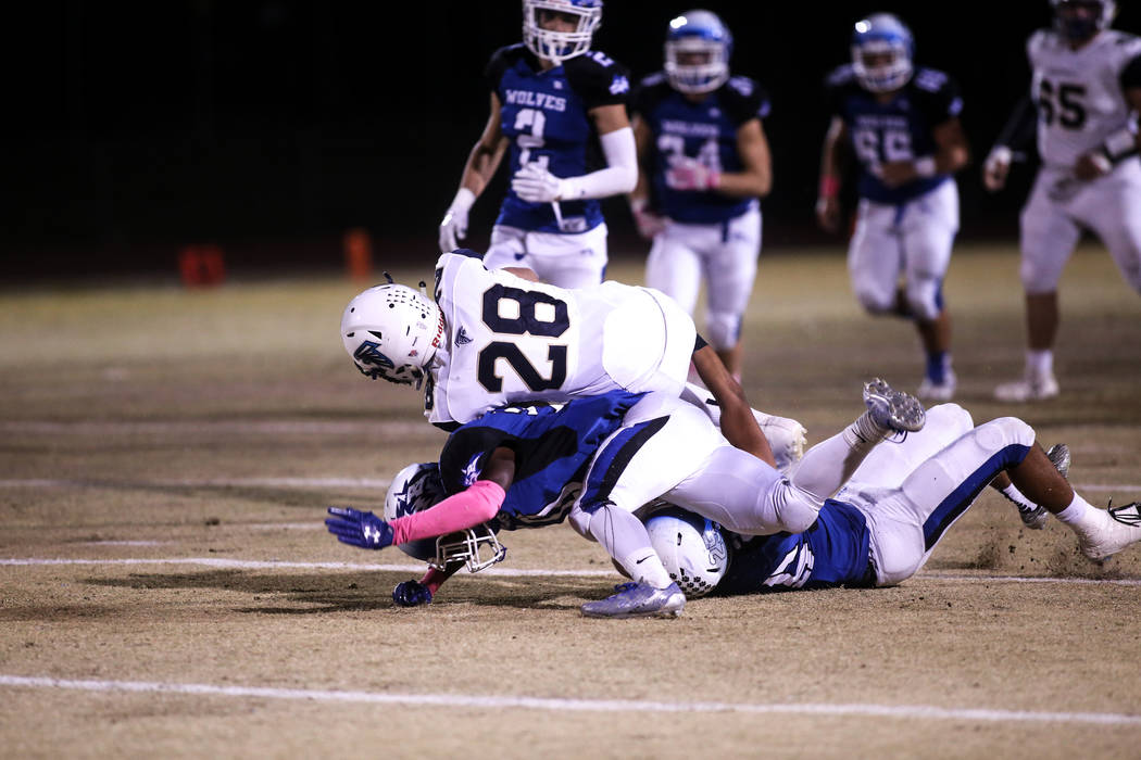 Foothill's Braeden Wilson (28), top, is tackled by Basic during the first quarter of a football game at Basic High School in Henderson, Friday, Oct. 20, 2017. Joel Angel Juarez Las Vegas Review-Jo ...
