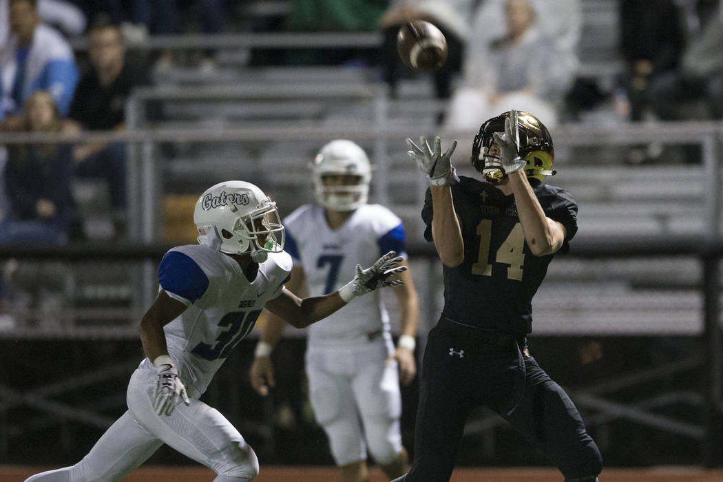 Faith Lutheran's Peyton Thornton (14) reaches for a catch against Green Valley in the football game at Faith Lutheran Middle School and High School in Las Vegas, on Monday, Aug. 21, 2017. Erik Ver ...