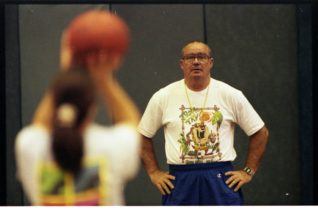 Basic High School girls basketball coach Jan Van Tuyl practices with his team in this 1994 photo.