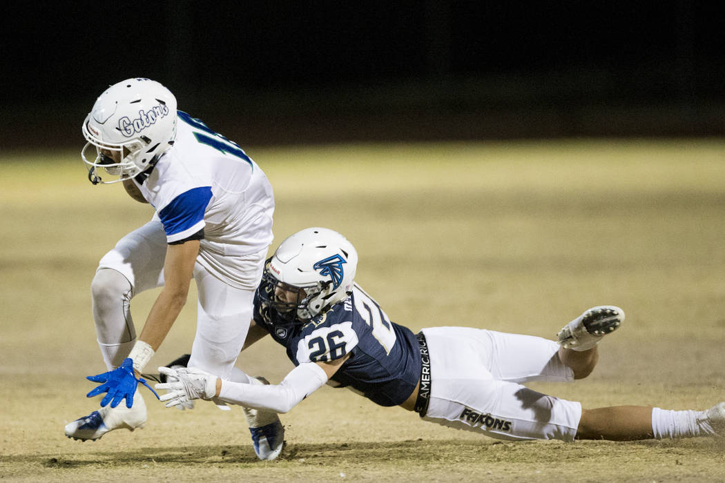 Green Valley's Kalyja Waialae (18) runs the ball against Foothill's Jace Derryberry (26) in the football game at Foothill High School in Henderson, Thursday, Oct. 26, 2017. Green Valley won 26-21. ...