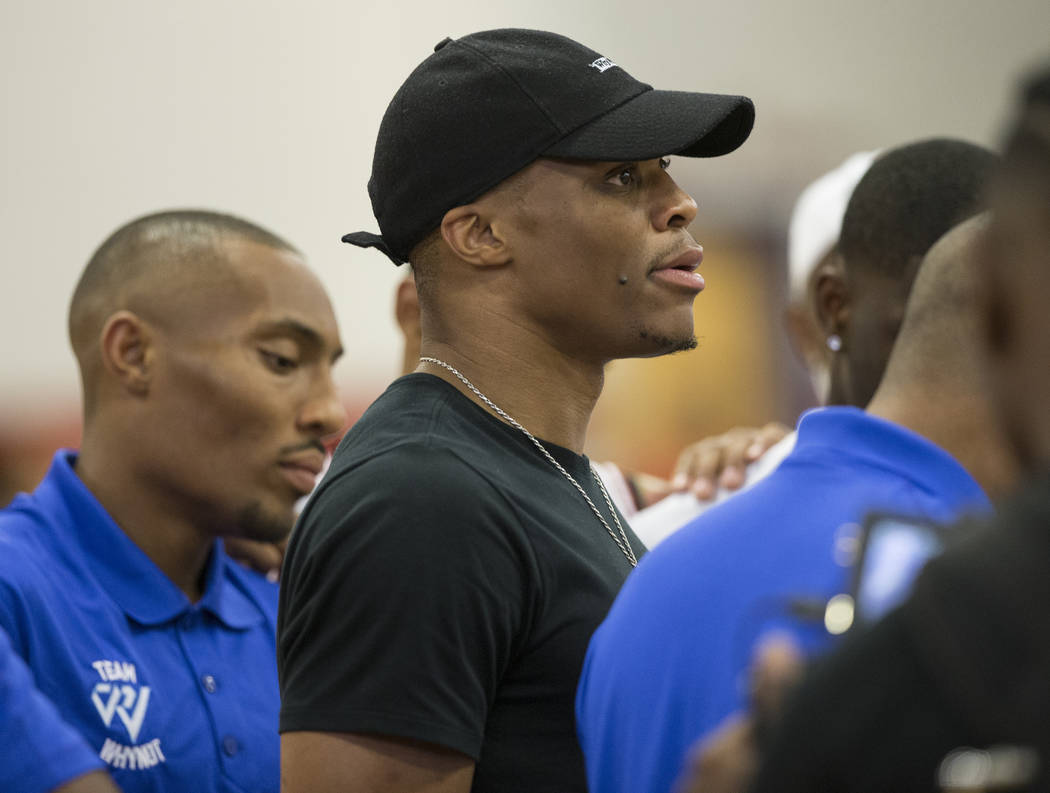 f9bdfe374897 Oklahoma City Thunder point guard Russell Westbrook cheers for Team Why Not  during the Made Hoops