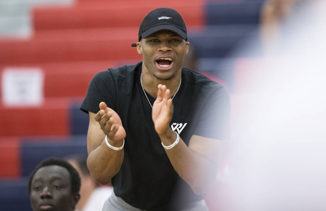 Oklahoma City Thunder point guard Russell Westbrook cheers for Team Why Not during the Made Hoops Summer Showcase on Wednesday, July 25, 2018, at Liberty High School, in Las Vegas. Benjamin Hager ...