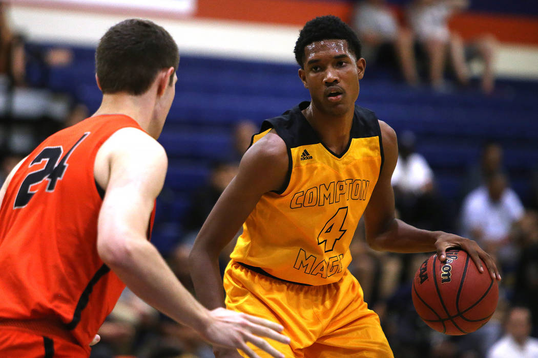 Compton Magic's Evan Mobley (4) attempts to pass Bishop Gorman's Myles Bendavid (24) at Bishop Gorman High School in Las Vegas, Wednesday, July 25, 2018. Rachel Aston Las Vegas Review-Journal @roo ...
