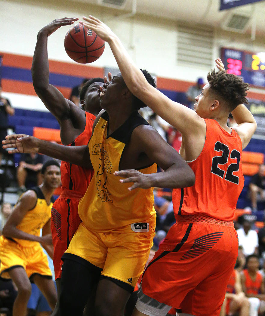 Compton Magic's Onyeka Okongwu (21) is blocked by Bishop Gorman's Braden Lamar (22) at Bishop Gorman High School in Las Vegas, Wednesday, July 25, 2018. Rachel Aston Las Vegas Review-Journal @rook ...