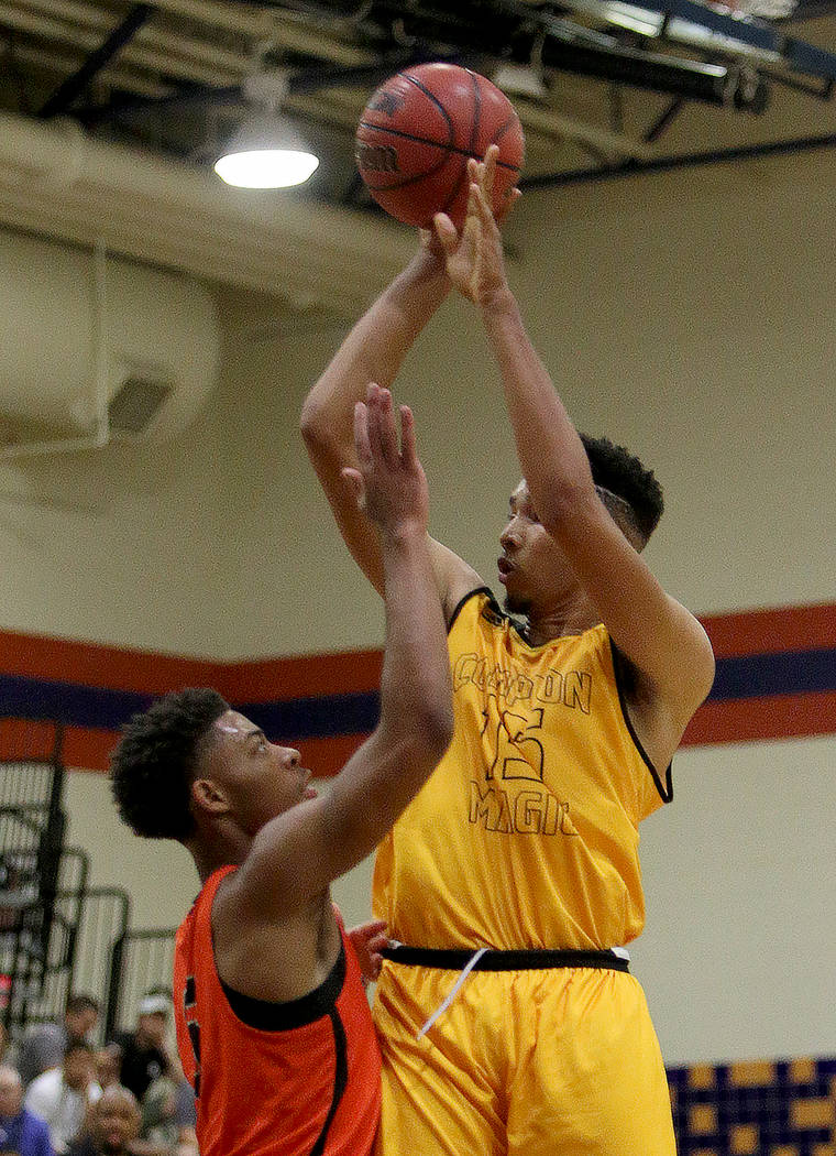Compton Magic's Isaiah Mobley (15) tries for a three pointer against Bishop Gorman's Jamal Bey (5) at Bishop Gorman High School in Las Vegas, Wednesday, July 25, 2018. Rachel Aston Las Vegas Revie ...