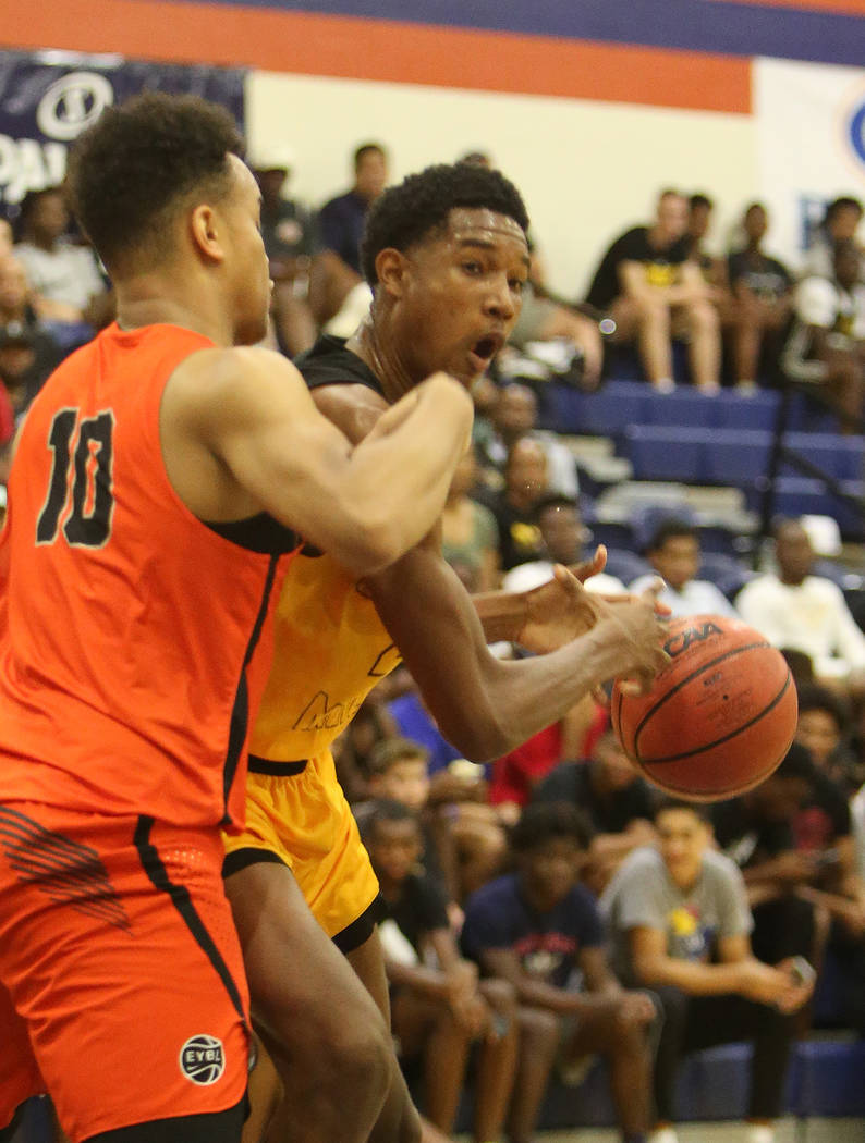 Compton Magic's Evan Mobley (4) tries to get the ball past Bishop Gorman's Zoan Collins (10) at Bishop Gorman High School in Las Vegas, Wednesday, July 25, 2018. Rachel Aston Las Vegas Review-Jour ...
