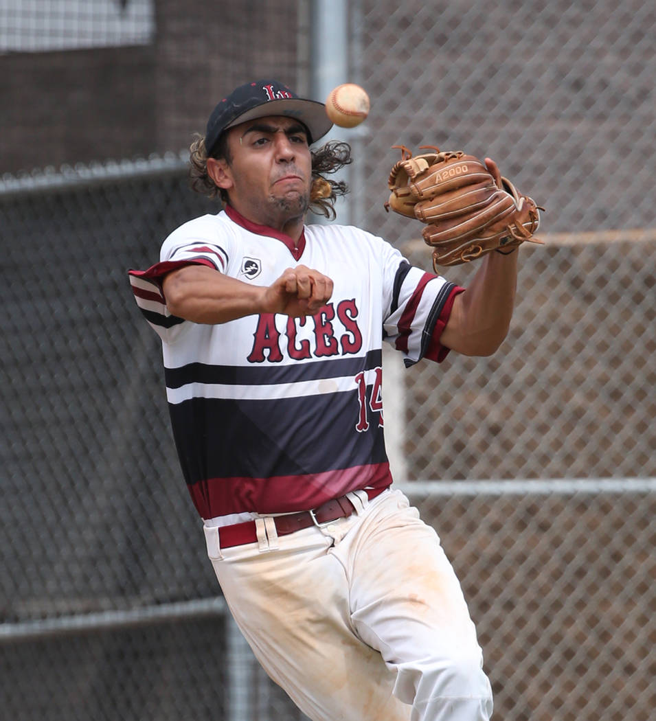 Desert Oasis' third baseman Israel Gutierrez throws to second during a game against Silverado High at Desert Oasis High School on Friday, July 13, 2018, in Las Vegas. Bizuayehu Tesfaye/Las Vegas R ...