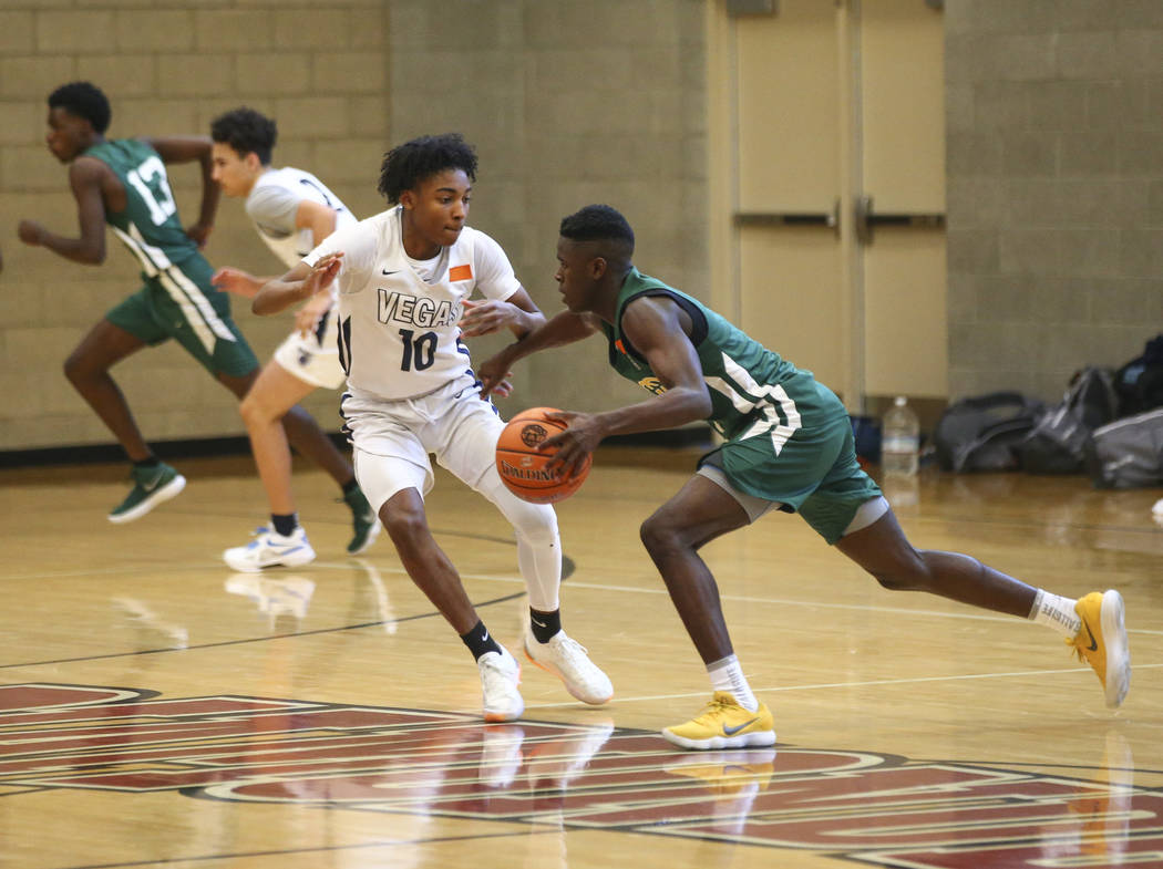 Vegas Elite guard Zaon Collins (10) defends a player from We All Can Go as part of the Fab 48 tournament at Desert Oasis High School in Las Vegas on Friday, July 27, 2018. Chase Stevens Las Vegas ...
