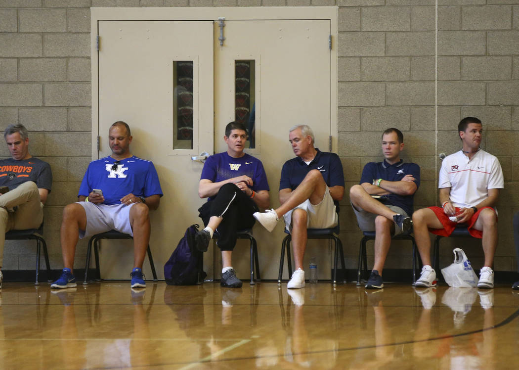 Former UNLV basketball head coach Dave Rice, now an assistant coach at the University of Washington, thid from left, talks with BYU head coach Dave Rose of the Fab 48 tournament at Desert Oasis Hi ...