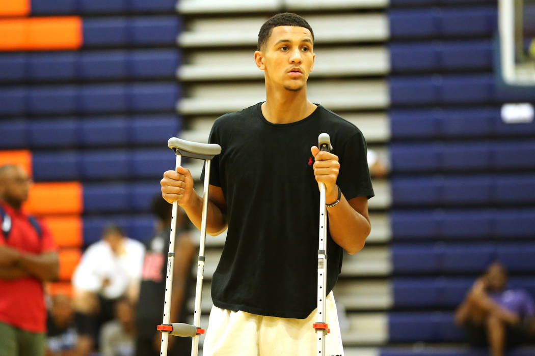 Grassroots Sizzle's Jalen Suggs watches his team warm up for their basketball game at Bishop Gorman High School in Las Vegas, Thursday, July 26, 2018. Suggs was injured the day before and did not ...
