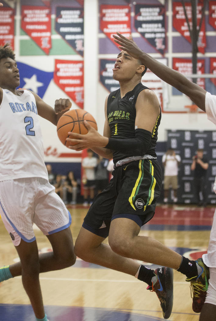 Las Vegas Prospects guard Julian Strawther (1) drives past Seattle Rotary forward Jaden McDaniels (2) in the first half during the Made Hoops Summer Showcase on Wednesday, July 25, 2018, at Libert ...