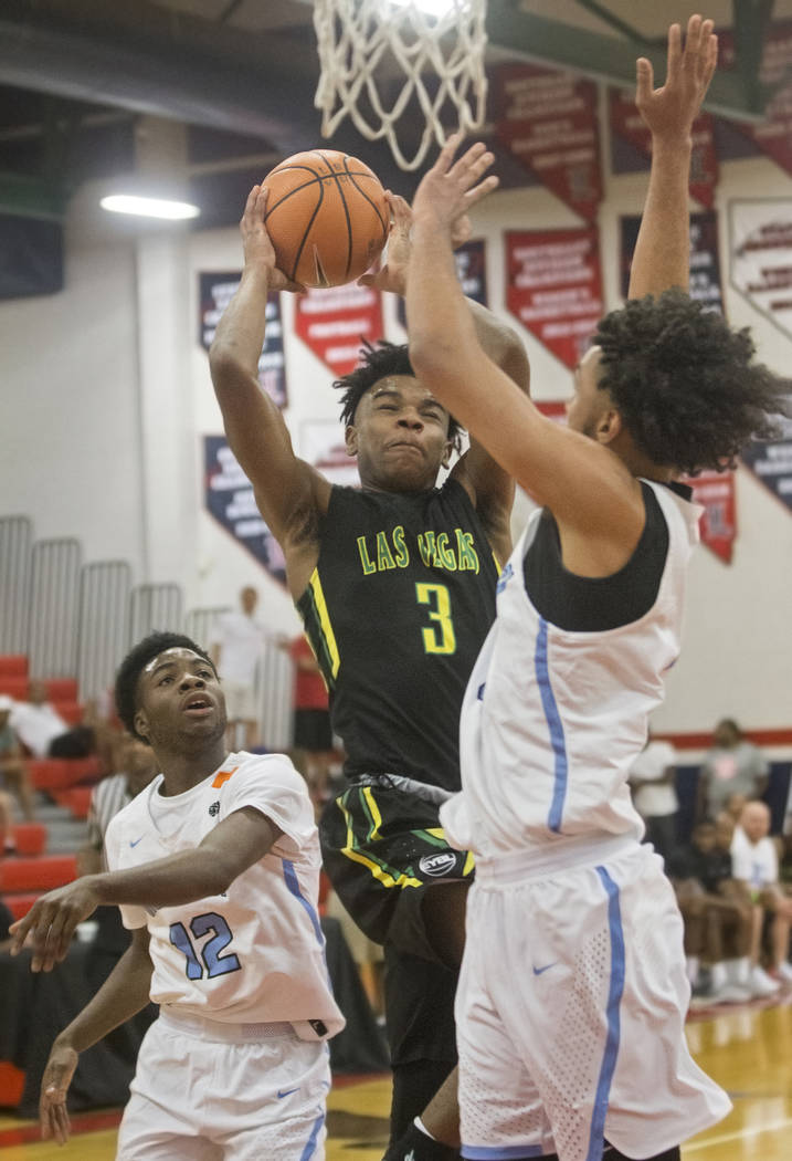 Las Vegas Prospects point guard Jaden Hardy (3) drives past Seattle Rotary defenders Jaden McDaniels (2) and Jishai Miller (12) in the first half during the Made Hoops Summer Showcase on Wednesday ...