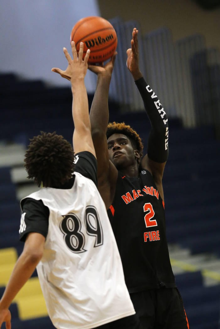 Mac Irvin Fire's Kahlil Whitney (2) shoots over California Stars' Gary Williams (89) during the first half of the Las Vegas Classic platinum premier championship game at Spring Valley High School ...